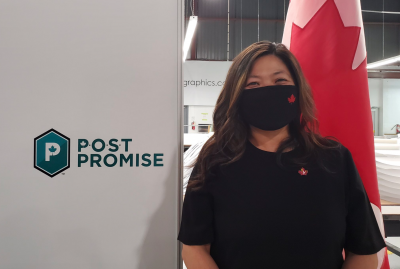 Post Promise sign and lady standing beside it